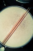picture of drums  - A worn-out wooden snare drum and drumsticks