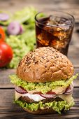 pic of hamburger  - Hamburger on wooden table with cheese and vegetable - JPG