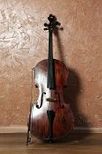 image of cello  - Cello on brown wall background - JPG