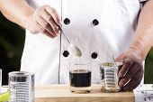 foto of condensation  - Chef putting condensed milk in to Hot coffee - JPG