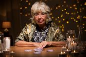 picture of fortune-teller  - Picture of mature fortune teller with tarot cards - JPG