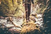 picture of survival  - Feet Man hiking outdoor with river and forest on background Lifestyle Travel survival concept - JPG