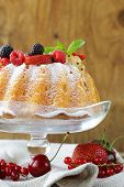 stock photo of sponge-cake  - festive dessert round sponge cake homemade pastries - JPG