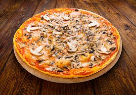 stock photo of crust  - Delicious pizza with mushrooms  - JPG