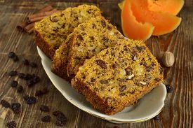 foto of pumpkin pie  - Spicy pumpkin cupcake with raisins and nuts - JPG