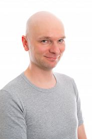 foto of bald head  - funny young man with bald head is smiling in to the camera - JPG