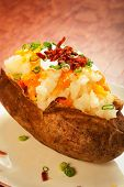 pic of baked potato  - Baked potato loaded with cheese green onion sour cream and bacon - JPG