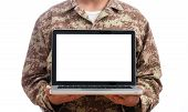 Young Soldier Showing A Laptop With Blank Screen On White Background poster
