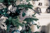 Christmas Tree With Blue And White Toys In The Interior.christmas Card With White And Blue Decor.vin poster