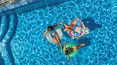 Aerial Top View Of Family In Swimming Pool From Above, Happy Mother And Kids Swim On Inflatable Ring poster