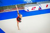 Adorable Gymnast Participates In Competitions In Rhythmic Gymnastics poster