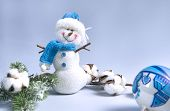 Composition In Blue, Snowman, Green Spruce Branch, Cotton Branch, Blue Christmas Ball, On A Blue Bac poster