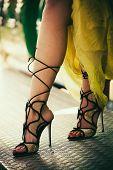woman legs in elegant high heel sandals sit closeup summer day poster