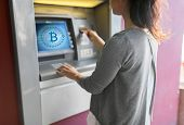 finance, cryptocurrency and technology concept - close up of woman hand inserting bank card to atm m poster