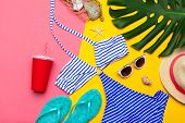 Beachwear And Accessories On A Pink And Yellow Background poster