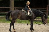 Sport, Activity, Entertainment. Child Smile In Rider Saddle On Animal Back. Equine Therapy, Recreati poster