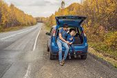 Dad And Son Are Resting On The Side Of The Road On A Road Trip. Road Trip With Children Concept poster
