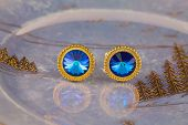 Vintage Large Gold Blue Stone Cuff Links On A Lustrous Plate poster