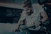 Bicycle Shop. Man Riding On Bicycle. Guy Checks The Bike. Man Looking On His Bicycle. Young Beard Ma poster