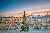 Helsinki, Finland. Christmas Xmas Market With Christmas Tree On Senate Square In Sunset Sunrise Even poster