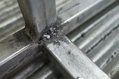 Close Up Of Steel Welding. Welding Steel Square Tube. Background And Texture Of Steel Welding. poster
