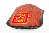 A package of ground meat wrapped in cellophane with a family size sticker. poster