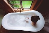 Woman Relaxing And Fun With Foam Bubble Bath In Jacuzzi Luxury Bathtub, Happiness And Relaxing Conce poster