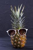 Hawaiian Ananas Wearing Sunglasses. Funny Pineapple Fruit In Sunglasses On Dark Background. Concept  poster