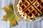Belgian Waffles And Autumn Maple Leaf On Light Wooden Table. Freshly Cooked Homemade Dessert, Remedy poster
