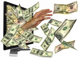 picture of holding money  - Many people got rich from the internet even money overflow - JPG