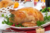 pic of horn plenty  - Garnished roasted turkey on fall festival decorated table with horn of plenty and red wine - JPG