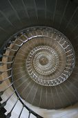 foto of spiral staircase  - Looking up through the centre of a spiral staircase - JPG