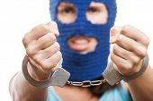 Russian protest movement concept - woman wearing balaclava or mask on head showing handcuffs on hand
