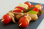 Vegetable Brochettes On A Black Slate Tray