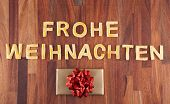 image of weihnachten  - the german word Frohe Weihnachten which means merry christmas with a gift - JPG