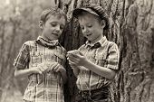 Young Stylish Boys Browse The Internet On Mobile Phone.