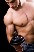 image of lifting weight  - Bodybuilder in action  - JPG
