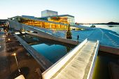 OSLO, NORWAY - JANUARY 1: National Oslo Opera House shines at sunrise on January 1, 2013. Oslo Opera