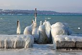 stock photo of freezing temperatures  - Very cold temperature give ice and freeze at the lake Leman border in Geneve - JPG