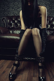 image of leather-bound  - Sexy gothic girl with legs in leg cuffs - JPG