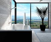 Modern bathtub in a bathroom interior with floor to ceiling windows with panoramic view
