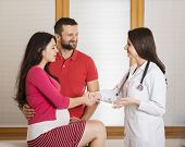 picture of gynecological exam  - Young pregnant woman with husband and doctor in hospital - JPG