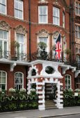 image of front door  - An ornate building in London flying the British flag - JPG