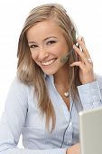 foto of dispatch  - Happy blonde dispatcher working - JPG
