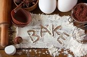 pic of ingredient  - Baking utensils spices and food ingredients on wooden board close - JPG