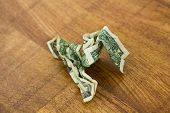 Scrunched Up Dollar Bill