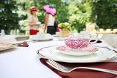 stock photo of table manners  - Tea cup and place setting at a tea party - JPG
