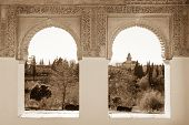 image of harem  - Arches of Generalife palace in Alhambra with garden view - JPG