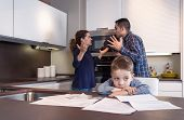 image of married couple  - Sad child suffering and his parents having hard discussion in a home kitchen by couple difficulties - JPG