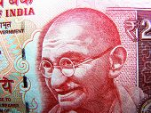 foto of gandhi  - mahatma gandhi known as father of india nation on indian rupee currency - JPG